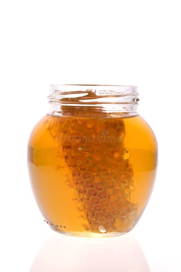 Miele fresco con il favo immagini stock libere da diritti
