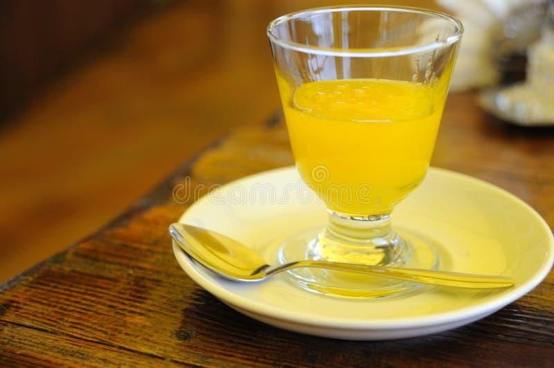Miele in un vetro immagine stock