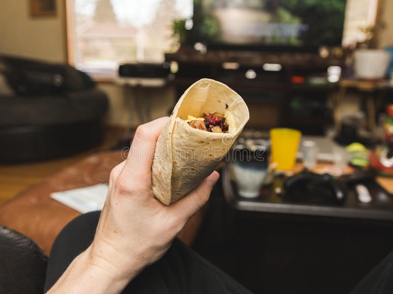 Mienia Śniadaniowy Burrito w Żywym pokoju zdjęcia royalty free