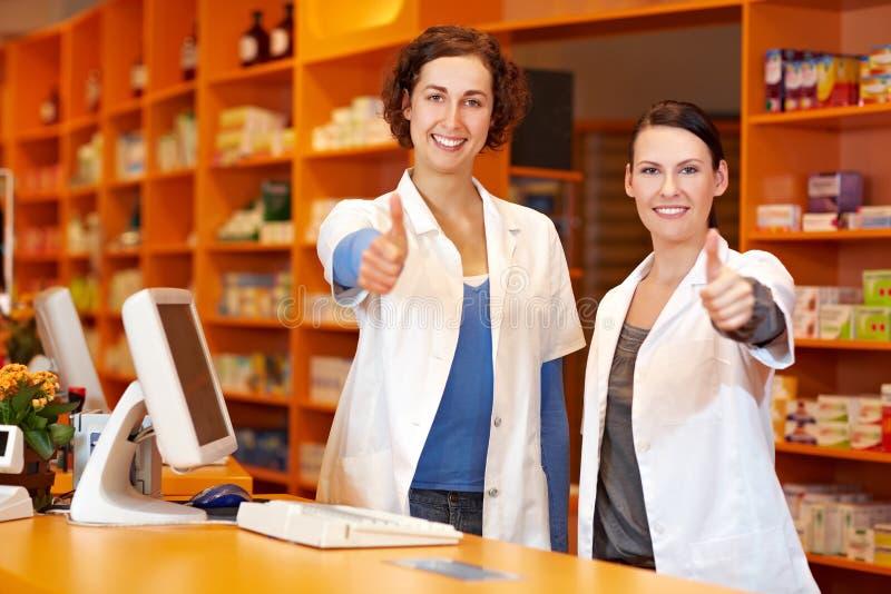 mienia farmaceut kciuki dwa obrazy royalty free