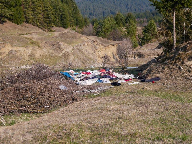 Human trash near pine forest, conceptual image of human negligence. Miercurea Ciuc, Romania-01 April 2019: Human trash near pine forest, conceptual image of royalty free stock images