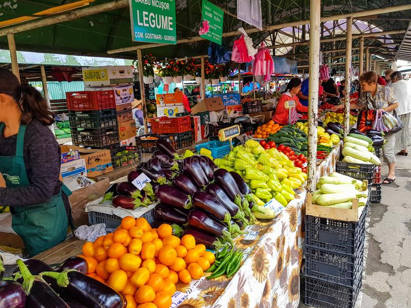 People buying fresh fruits and vegetables at the local market. Miercurea Ciuc, Romania-14 July 2018: People buying fresh fruits and vegetables at the local royalty free stock photography