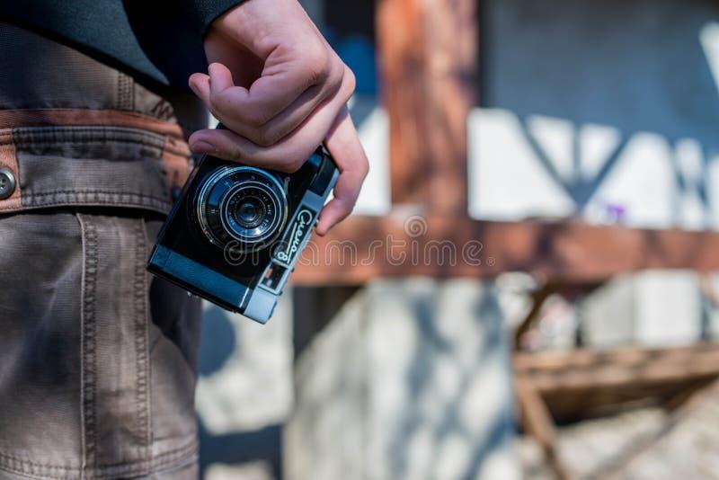 Young man using vintage russian   camera. stock photos