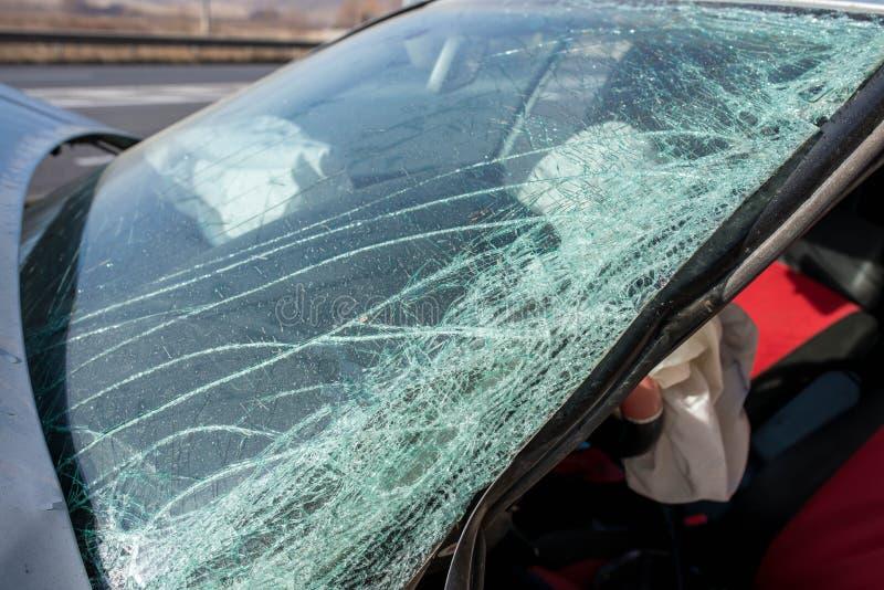 Broken windshield on Volkswagen Golf after side collision. stock image