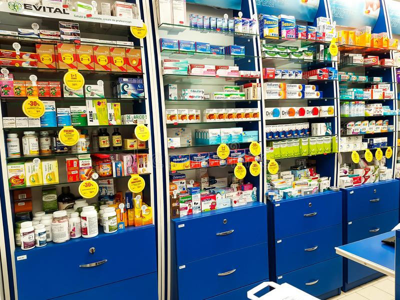 Shelves full with medicaments on local pharmacy store. Miercurea Ciuc, Romania-06 October 2018: Shelves full with medicaments on local pharmacy store royalty free stock photo