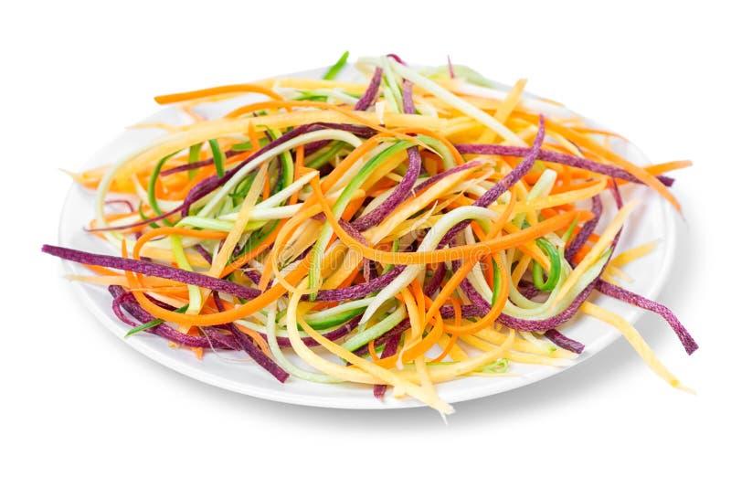 Miesza czerwień, kolor żółtego, pomarańczowe marchewki, zucchini i ogórka julienned, zdjęcia stock