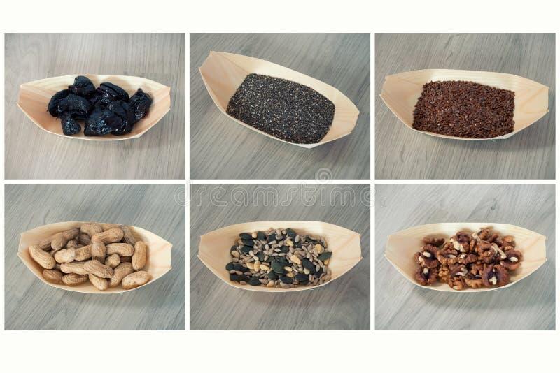 Mieszanka ziarna Wysuszone śliwki, chia ziarna, flaxseed, arachidy, słonecznikowi ziarna i dyniowi ziarna, greckie dokrętki zdjęcie royalty free