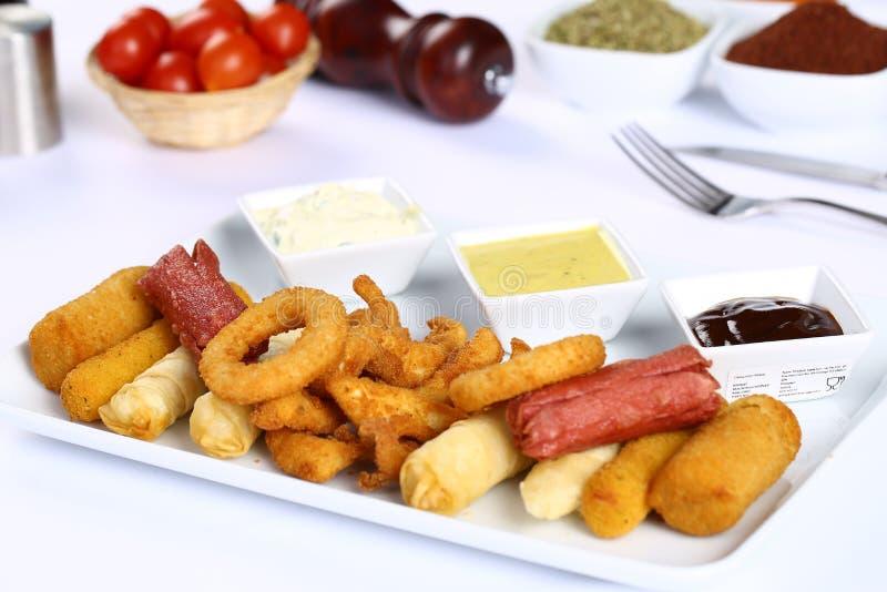 Mieszany francuz Smaży, kurczaków paski, cebulkowi pierścionki obraz stock