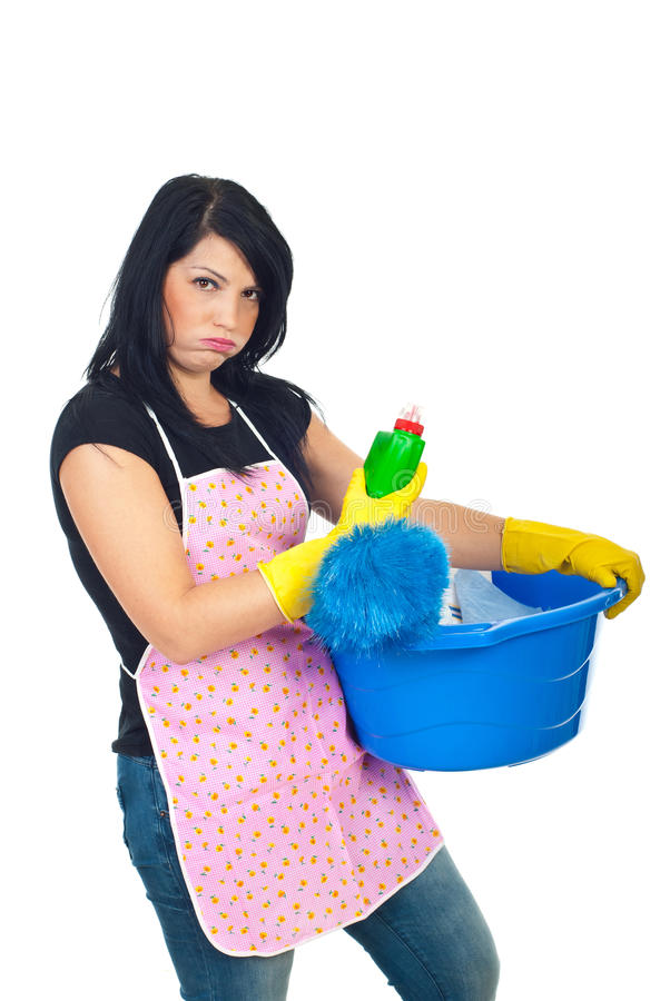 Miffed woman holding cleaning products royalty free stock photos