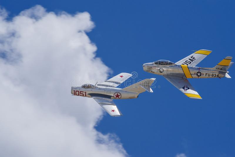 MIG-15 and American F-86F flyby royalty free stock photo