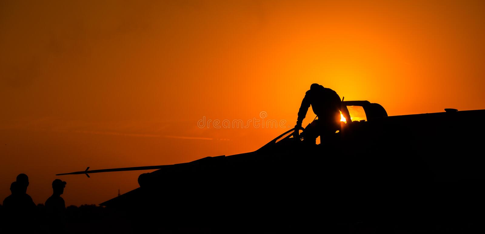 MiG-21 Lancer air fore pilot silhouette on sunset Top Gun fighter pilot royalty free stock images