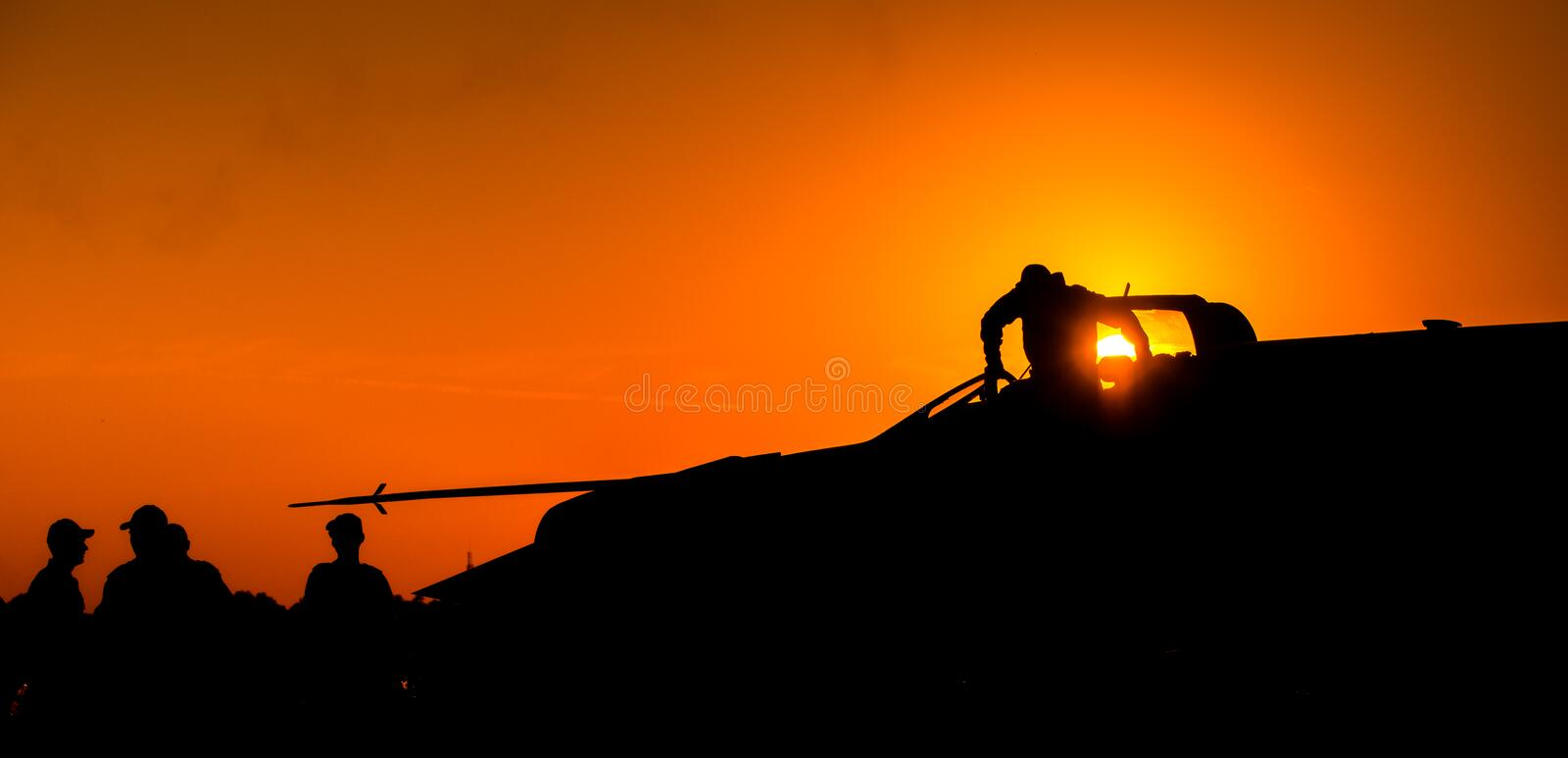 MiG-21 Lancer air fore pilot silhouette on sunset Top Gun fighter pilot royalty free stock image