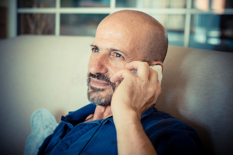 Download Miggle age man using phone stock image. Image of male - 33317211