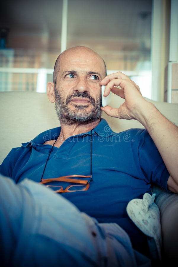 Download Miggle age man using phone stock photo. Image of connecting - 33317220