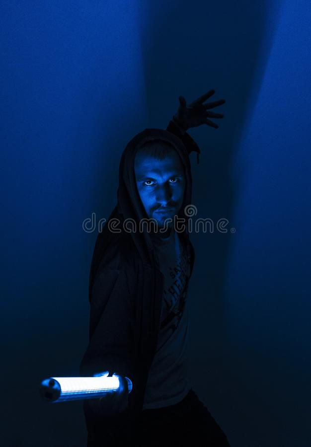 Mighty jedi gain power from a neon lamp, cyberpunk, futurism stock images