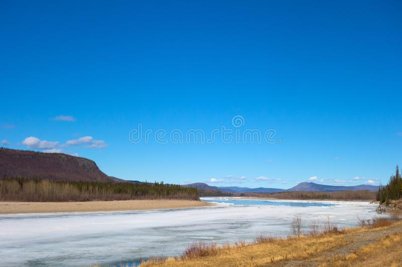 A river thawing in northern british columbia royalty free stock photo