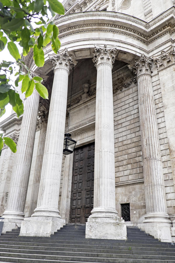 Mighty pillars supporting the portico over a door at St Paul's Cathedral, London, England stock images