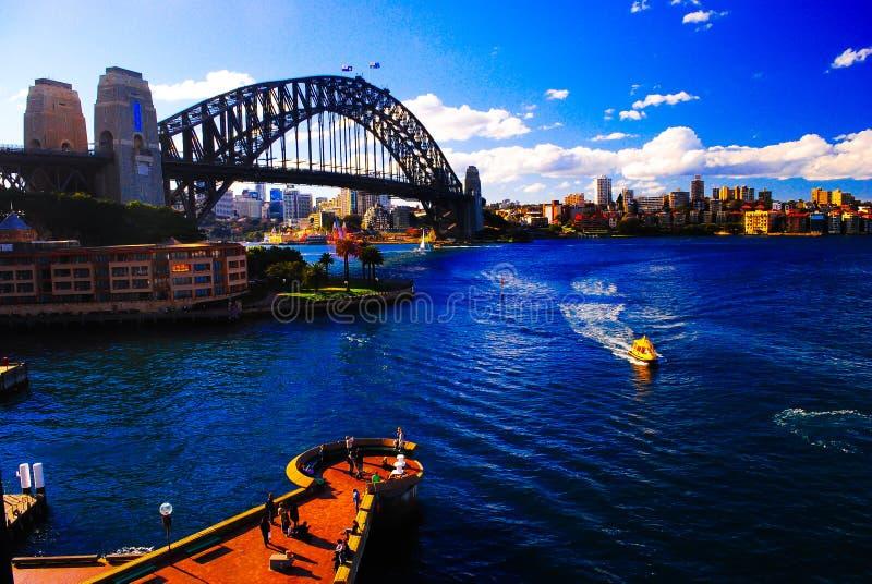 Mighty steel Sydney Harbor bridge crossing the ocean royalty free stock photos