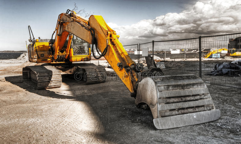 Mighty yellow excavator. With a bucket stock image