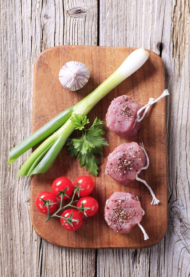 Mignons de filet crus de porc images stock