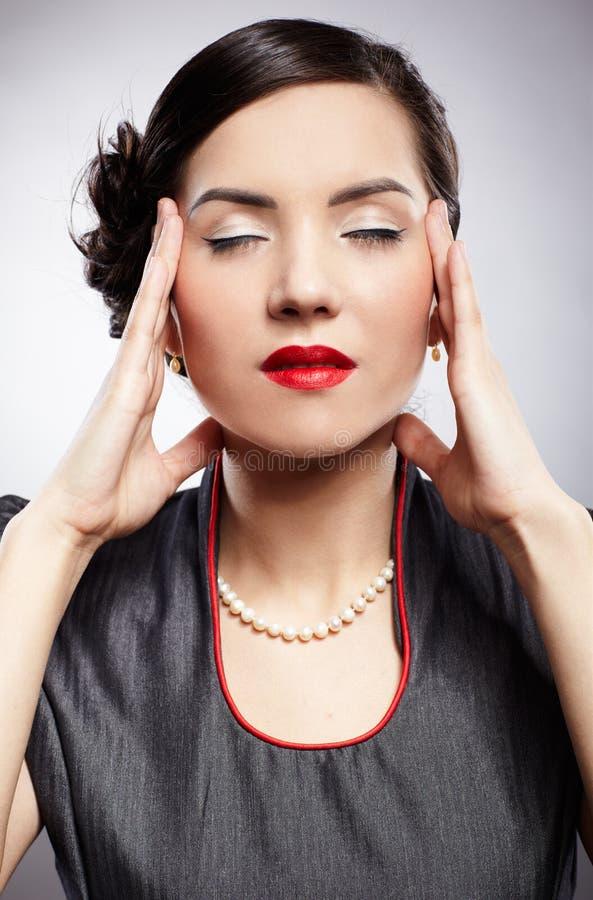Migraine. Portrait of girl with migraine headache royalty free stock photos