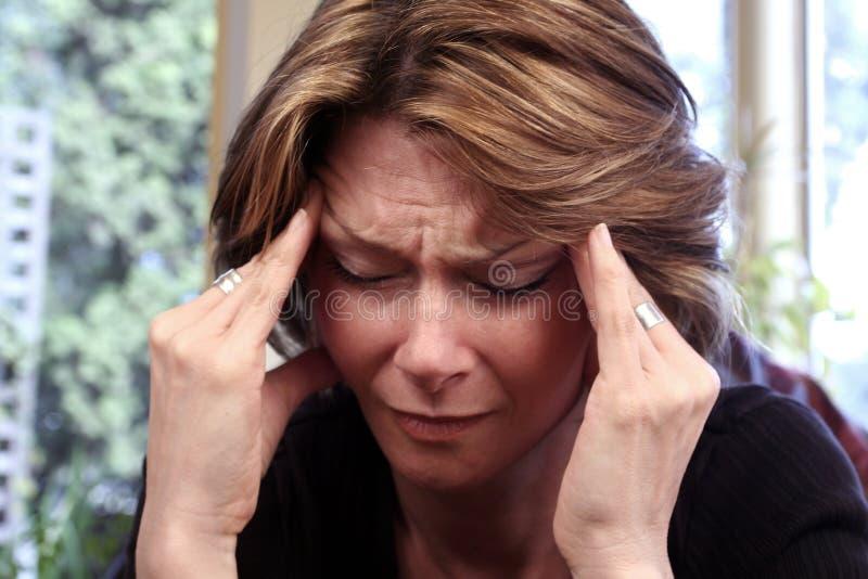 Migraine. Woman with migraine, focus on hair stock photo