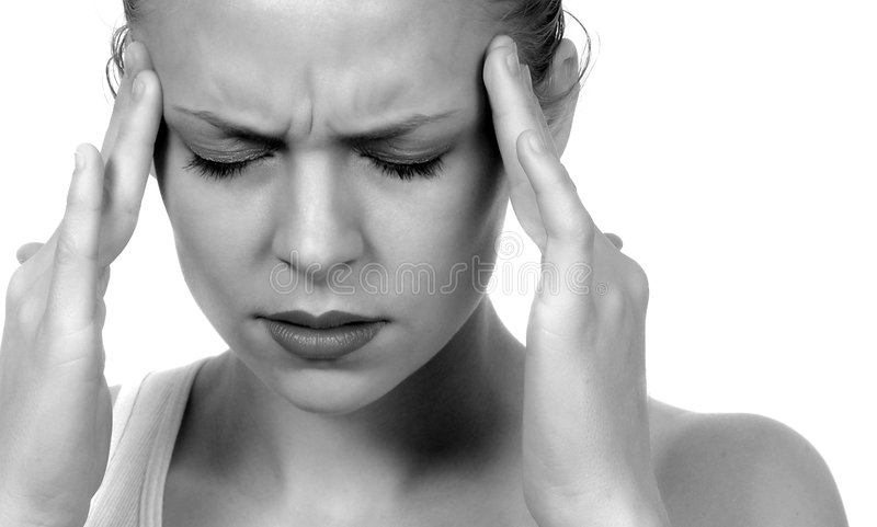 Migraine Headache. Woman with severe Migraine Headache holding hands to head royalty free stock photo