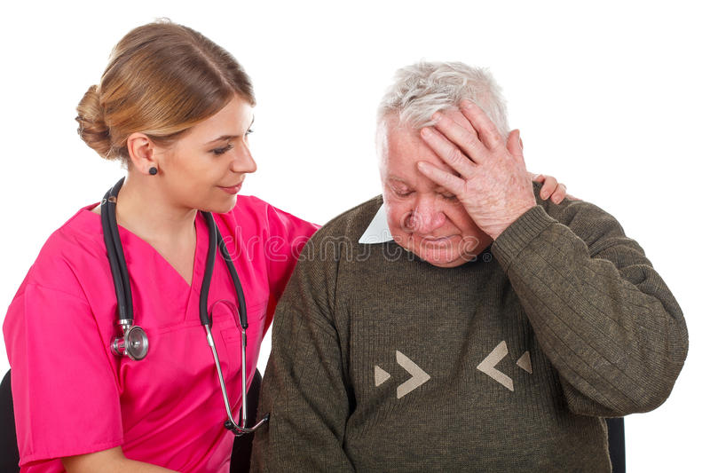 Migraine problems. Picture of an old men having a serious migraine - isolated background stock photos