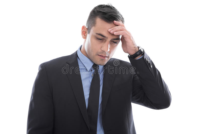 Migraine: young businessman with headache in business suit isolated on white background royalty free stock photography