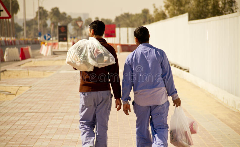 Migrant Workers in Doha, Qatar royalty free stock photos