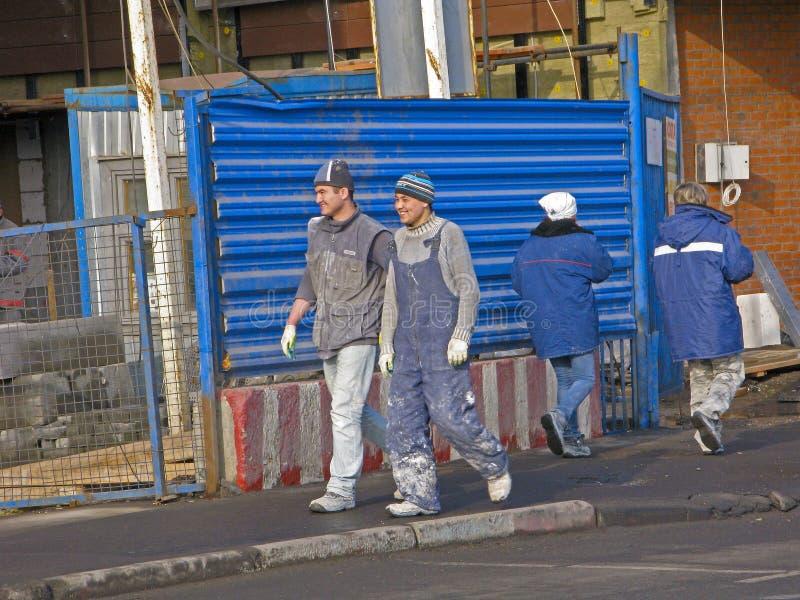Migranten in bouw stock foto's