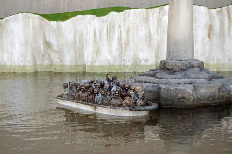 Migrantfartyglek, Dismaland arkivbild