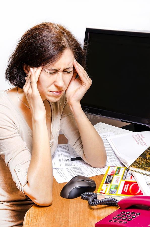 Migrena przy pracą zdjęcia royalty free