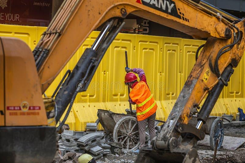 Migrerende werknemers het werken stock foto