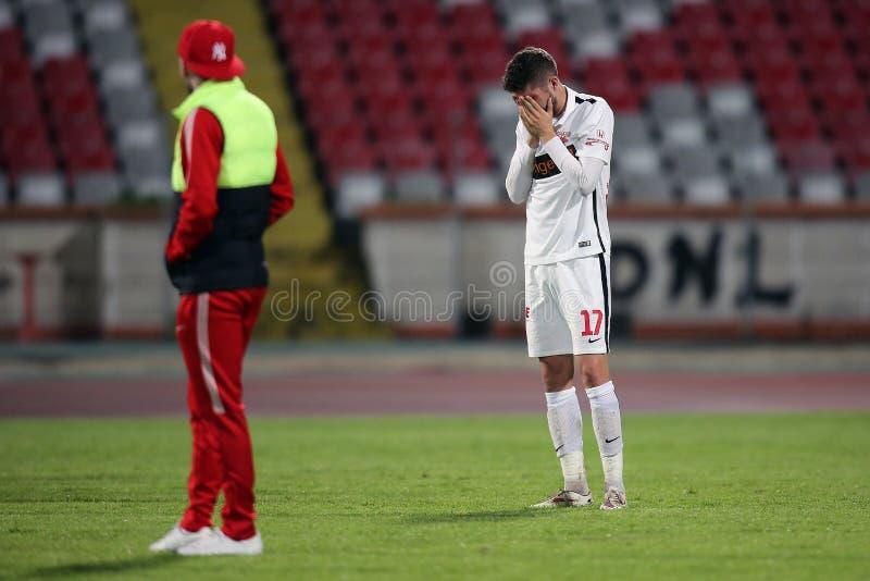 Miha Mevlja szokujący po jego współczłonka drużyny, Patrick Ekeng umierał na futbolowej smole fotografia stock
