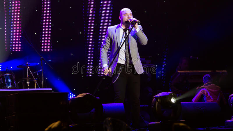 Mihai Georgescu. Alias Miță (vocals) from Bere Gratis (Free Beer) Band at New Years Eve 2014 concert organized by District 3, Bucharest stock photography