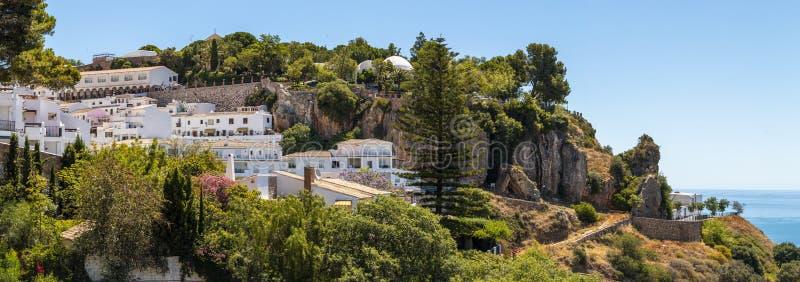 Mijas town. Villas and trees near sea royalty free stock image