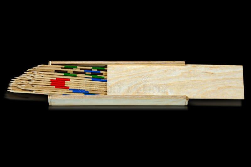 Mikado - träpinnar och ask arkivbilder