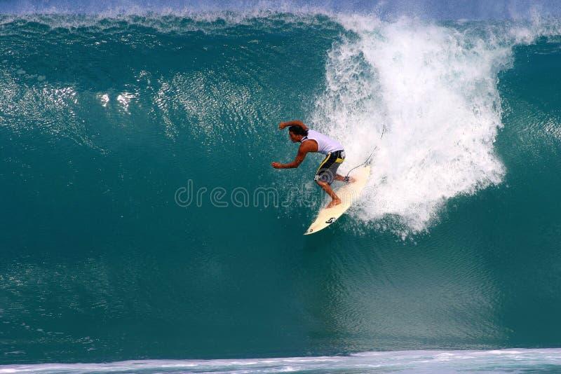Mikala Jones Surfing at Backdoor. Professional Surfer, Mikala Jones surfing at Backdoor on the North Shore of Oahu, Hawaii royalty free stock image