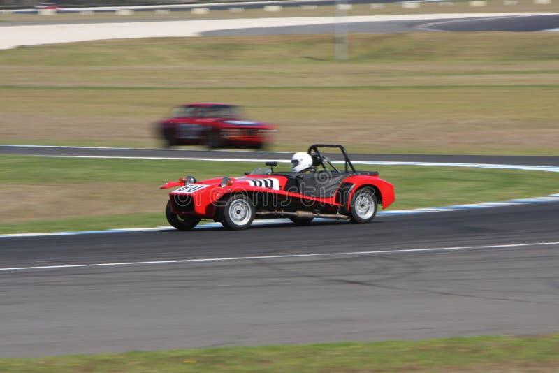 Mike Byrne compite con a su Lotus Seven S4 fotos de archivo