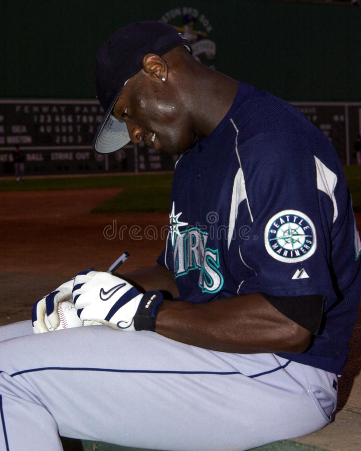 Mike Cameron, Seattle Mariners. Seattle Mariners OF Mike Cameron signs an autograph before the game. . (Image taken from color slide royalty free stock photography