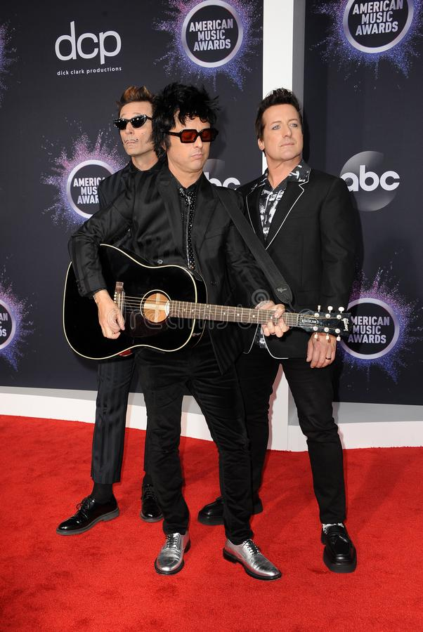 Mike Dirnt, Billie Joe Armstrong and Tré Cool of Green Day royalty free stock image