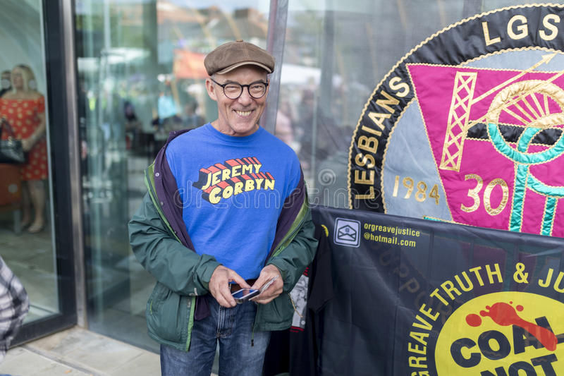 Mike Jackson, one of the founding members of the campaign group. Lesbian and Gays Support the Miners next to banners stock photos