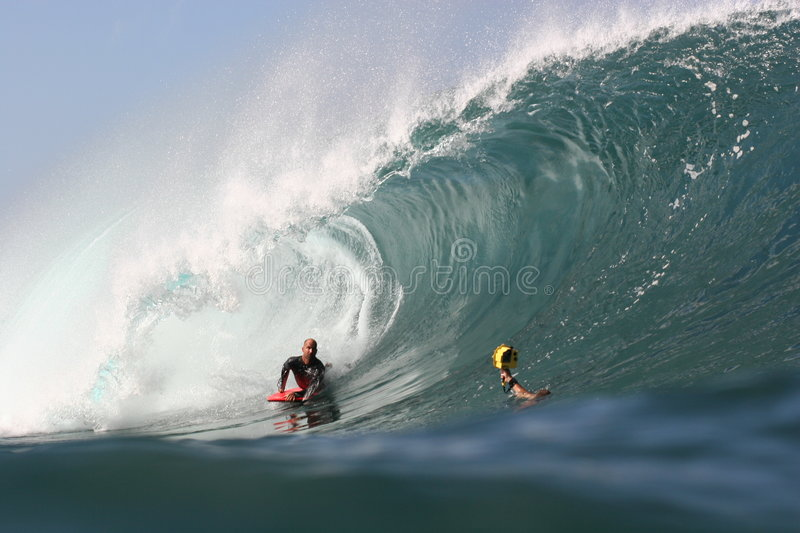 Mike Stewart at Pipeline. Professional body boarder Mike Stewart, practices for a contest at Pipeline in Hawaii stock photography