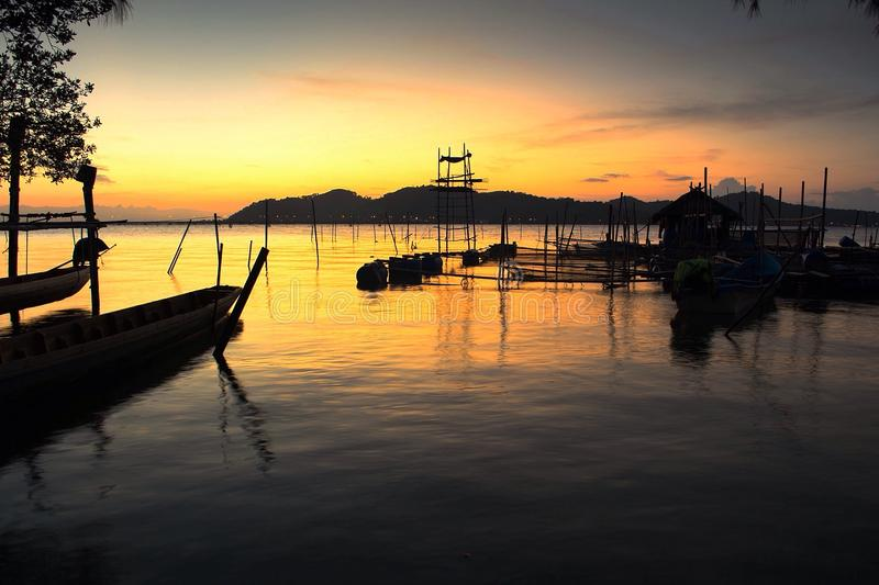 Mike sunset fishing village. Songkhla thailand royalty free stock photo