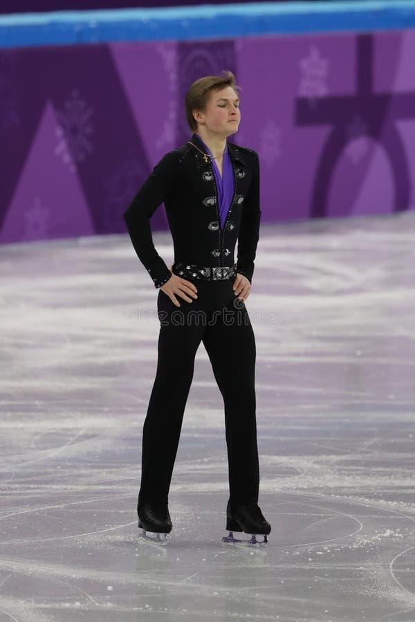 Mikhail Kolyada van Olympische Atleet van Rusland voert in Team Event Men Single Skating het Vrije Schaatsen bij het Olympische S stock foto