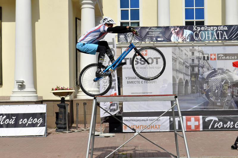Mikhail Sukhanov performance, champions of Russia on a cycle trial. City Day of Tyumen on July 26, 2014. Mikhail Sukhanov performance, champions of Russia on a royalty free stock image