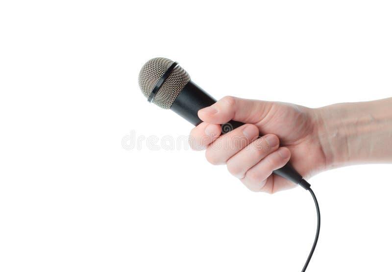 Mikrofon in der Hand lizenzfreie stockbilder