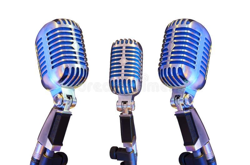 Mikrofon mit drei Weinlesen lokalisiert auf Weiß lizenzfreie stockfotos