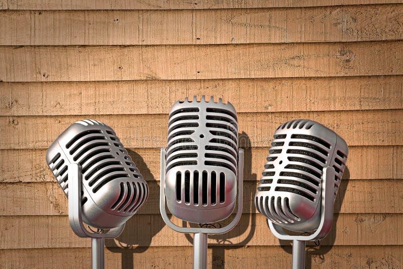 Mikrofonen för tappningmicstrio vaggar rulle som sjunger gruppen som musikbandet sjunger sångutrustning royaltyfri foto